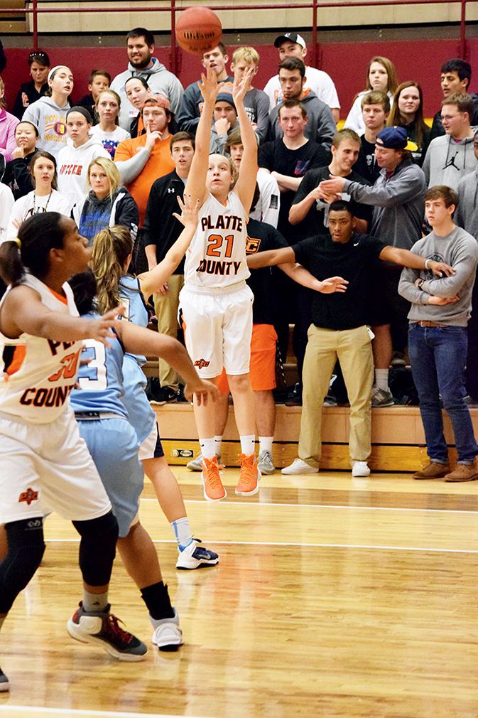 BRYCE MERENESS/Citizen photo Platte County freshman guard Jaycie Stubbs (21) takes a shot during the  Winnetonka Invitational gold bracket championship game on Friday, Dec. 4 at Winnetonka High School in Kansas City, Mo.