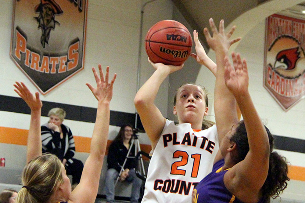 ROSS MARTIN/Citizen photo Platte County freshman guard Jaycie Stubbs, center, goes up for a shot between two Belton defenders on Thursday, Feb. 4 at Platte County High School.