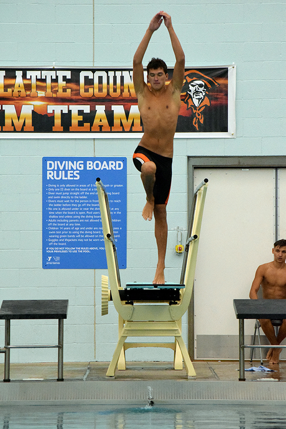 BRYCE MERENESS/Citizen photo Platte County senior Justin Richardson springs off the diving board during the Platte County Invitational on Saturday, Aug. 29 at Platte County Community Center North.