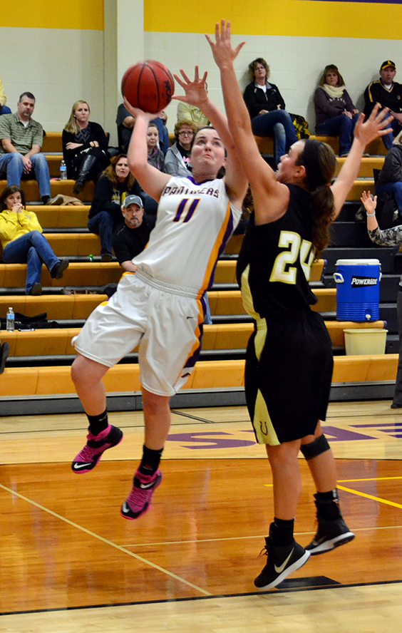 North Platte forward Kaycee Hodgson, left, attempts a shot vs. Lathrop on Friday, Feb. 6 at North Platte High School in Dearborn, Mo.