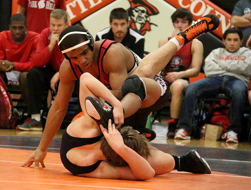 ROSS MARTIN/Citizen photo Park Hill senior Ke-Shawn Hayes, top, wrestles with Platte County's Ethan Karsten in the 145-pound match in a  dual between Platte County and Park Hill on Thursday, Jan. 18 at Platte County High School. Hayes won an 11-0 major decision.