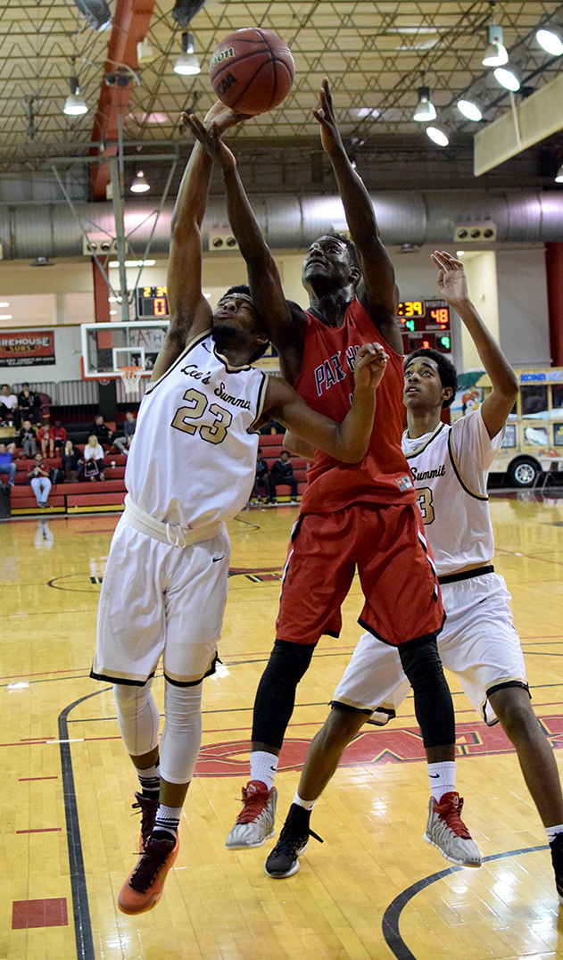 BRYCE MERENESS/Citizen photo Park Hill forward Kentrez Bell, center, fights for an entry pass between two Lee's Summit defenders during the William Jewell Holiday Classic's Patterson Division championship game Wednesday, Dec. 30 in Liberty, Mo.