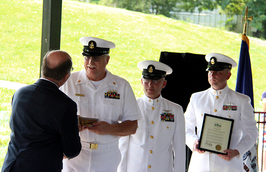 ROSS MARTIN/Citizen photo Charles Schley (second from left), a retired Chief Boatswain's Mate in the U.S. Navy, receives the key to the City of Platte City during a ceremony Saturday, July 4 at Settler's Crossing Park that dedicated an anchor from the USS Platte (AO-186), a decommissioned Cimarron class fleet oiler, to be displayed at the site. Schley served on the commissioning crew for the USS Platte, the second boat to bear the name of the Platte River, and he flew in from Pennsylvania to be a guest of honor.