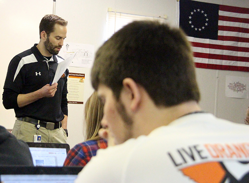 ROSS MARTIN/Citizen photo Platte County history teacher Kiel Giese, left, goes over a study guide with a class on the morning of Tuesday, Jan. 26 at Platte County High School. Giese is one of eight teachers set to participate in a pilot program this fall that will offer students a new flexible scheduling model.