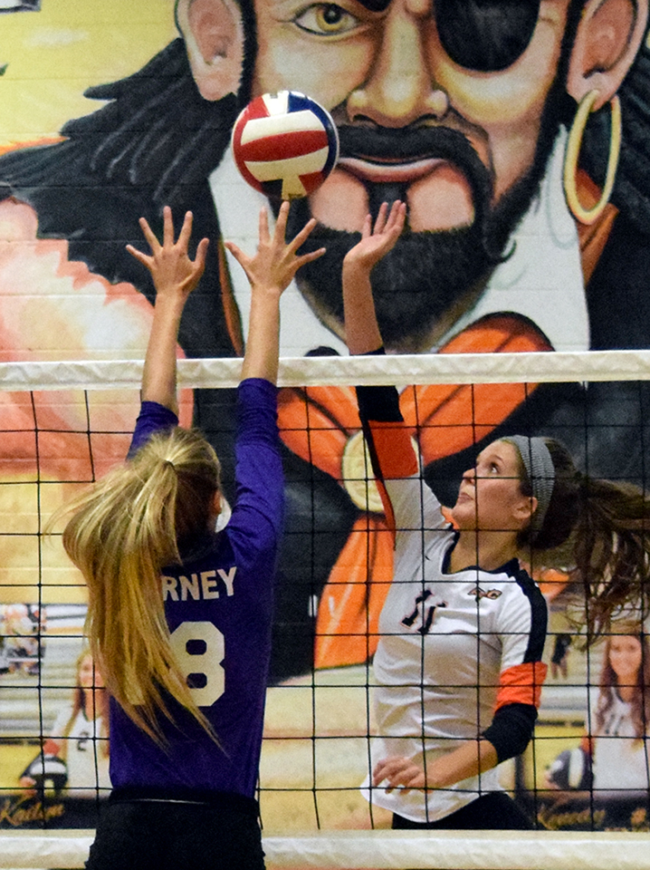 BRYCE MERENESS/Citizen photo Platte County senior Kenedy Knox, right, tips the ball over the net in a match against Kearney on Thursday, Oct. 8 at Platte County High School.