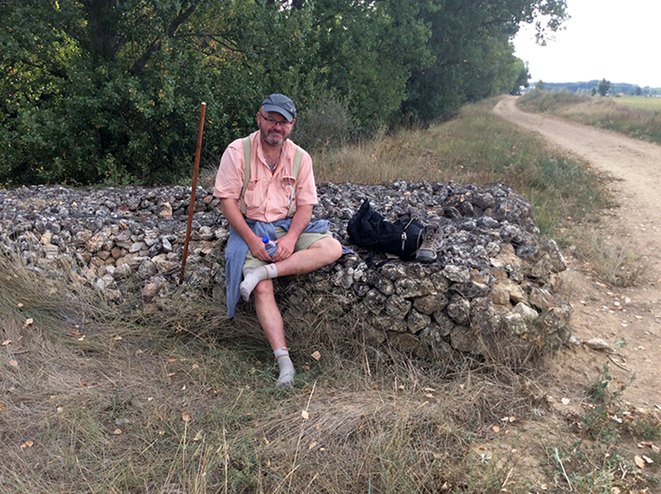 JOHN LARIMER/Special to the Citizen John Larimer stops to rest along the Camino de Santiago trail in Spain to rest his feet.