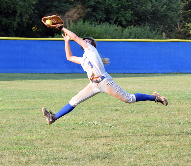 BRYCE MERENESS/Citizen photo West Platte sophomore Kaitlin Larison snares a line drive during a game against DeKalb on Monday, Aug. 31 at Benner Park in Weston, Mo. DeKalb won 16-6 to drop the Bluejays to 0-8 on the season.