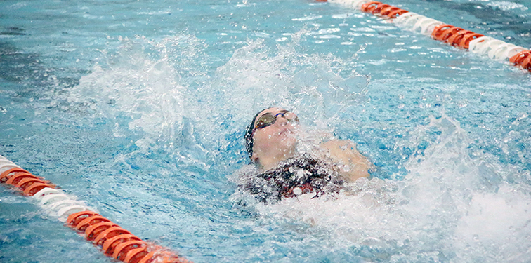 ROSS MARTIN/Citizen photo Platte County's Lauren Earnest swims the backstroke on her leg of the 200-yard medley relay on Thursday, Dec. 4 during a meet with Park Hill South at Platte County Community Center North in Platte City.
