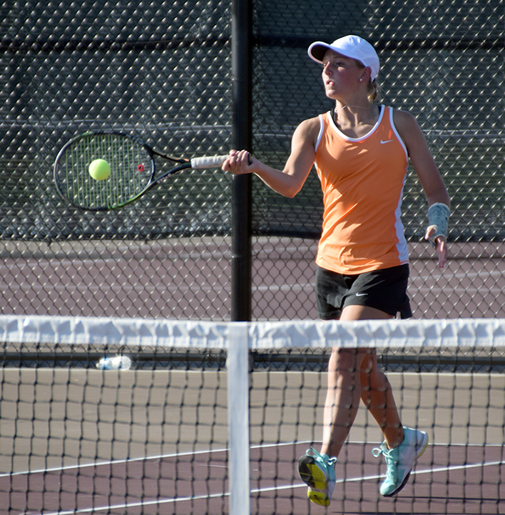 BRYCE MERENESS/Citizen photo Platte County junior Stephanie Laures hits a return during a doubles match with her partner freshman Hannah Valentine on Monday, Aug. 24 at Winnetonka High School in Kansas City, Mo.
