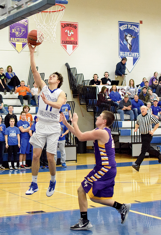 BRYCE MERENESS/Citizen photo West Platte senior guard Luke Horseman, left, goes up for a layup with North Platte's Austin Snook defending during a KCI Conference matchup Friday, Jan. 8 at West Platte High School in Weston, Mo. Horseman hit seven 3-pointers and scored 23 points.