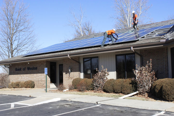 Workers installed 80 solar energy panels on the roof at Bank of Weston in Weston last week. Bank officials said its Platte City and KCI locations will also be outfitted with the panels this spring. SARA LOVELACE/Citizen photo