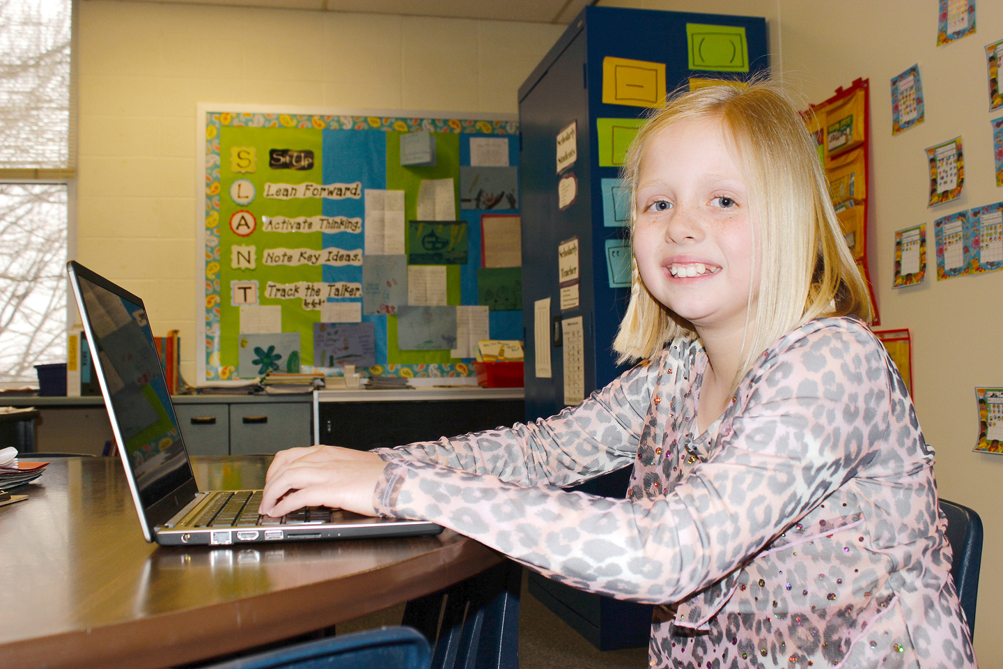 Park Hill School District student Jessica Binckley, 11, used a laptop provided by the District to create an award winning video about childhood obesity. SARA LOVELACE/Citizen photo