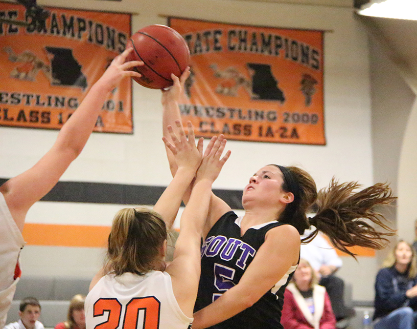 ROSS MARTIN/Citizen photo Platte County's Rachel Holden (not pictured) blocks a shot attempt from Park Hill South's Mackenzie Stout during a game Thursday, Dec. 11 at Platte County High School.