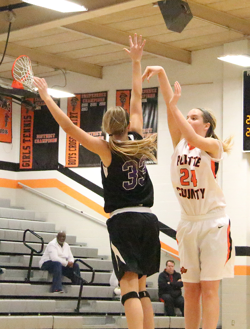 ROSS MARTIN/Citizen photo Platte County junior Madysen Fine, right, attempts a shot against Park Hill South sophomore Emily Dinovo on Thursday Dec. 11 at Platte County High School.