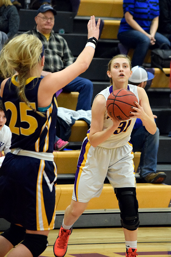 BRYCE MERENESS/Citizen photo North Platte senior guard Erin Manville, right, eyes a shot against Hamilton on Friday, Jan. 22 at North Platte High School in Dearborn, Mo.
