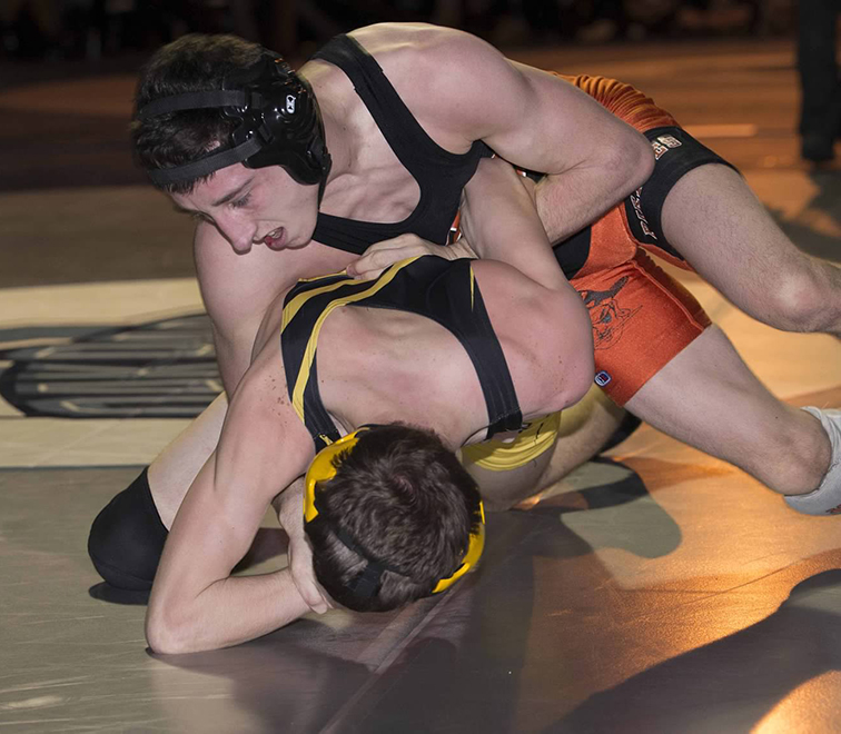 DAVID BREDESON/Special to The Citizen Platte County's Matthew Schmitt, top, works against Smith-Cotton's Blake Pomajzl during the 126-pound championship bout of the Class 3 District 4 tournament on Saturday, Feb. 14 at Oak Park High School in Kansas City, Mo.