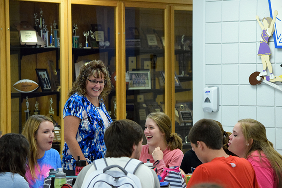 BRYCE MERENESS/Citizen photo North Platte junior and senior high school principal Michelle Johnson chats with students during lunch on Monday, Aug. 31 in Dearborn, Mo.