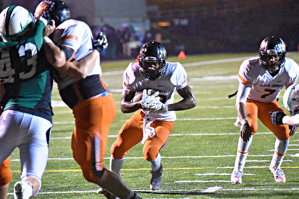 TODD NUGENT/Special to The Citizen Platte County running back Mike McNair, center, runs through a hole toward the end zone during a Class 4 District 8 matchup with Smithville on Friday, Oct. 30 at Smithville High School in Smithville, Mo. McNair scored three touchdowns in a 23-7 win.