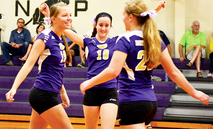 BRYCE MERENESS/Citizen Photo North Platte junior Katie Heese, left, and senior Baylie Wilson celebrate a point against Bishop LeBlond on Aug. 28 at North Platte High School in Dearborn, Mo.