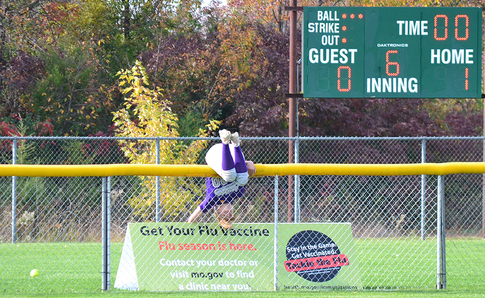 BRYCE MERENESS/Citizen photo North Platte senior center fielder Regan Nash goes over the fence to try and catch what ended up being a two-run home run for Fatima's Christine Brunnert during a Class 2 state semifinal Oct. 24 at Killian Softball Complex in Springfield, Mo. North Platte lost 6-0.