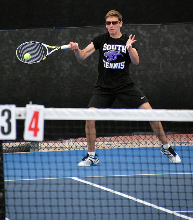 BRYCE MERENESS/Citizen photo Park Hill South's JD Nassab hits a return in a doubles match with partner Josh Robaska (not pictured) in the A doubles championship match of the Suburban Conference Northland Tournament on Saturday, May 2 at Oak Park High School in Kansas City, Mo.