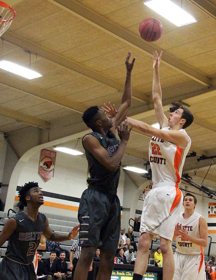 ROSS MARTIN/Citizen photo Platte County senior forward Nick Kunels (22) takes a hook shot over multiple Belton defenders during a game Monday, Jan. 4 at Platte County High School in Platte City.