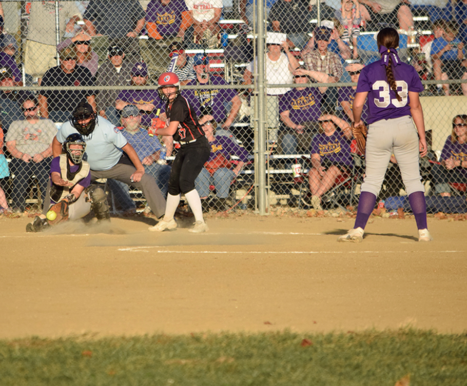 BRYCE MERENESS/Citizen photo North Platte sophomore Alley Rickel, left, attempts to block a pitch in the dirt during the seventh inning of North Platte's 3-0 loss to Sherwood in a Class 2 sectional at Sherwood High School in Creighton, Mo. Rickel entered after senior catcher Martina Williams left the game with a possible concussion after a foul tip hit her mask.