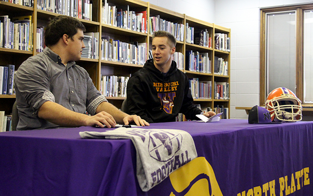 ROSS MARTIN/Citizen photo North Platte senior teammates John Collins, left, and Jordan Hendricks signed to play football at Missouri Valley during a ceremony held Wednesday, Feb. 3 at North Platte High School in Dearborn, Mo.