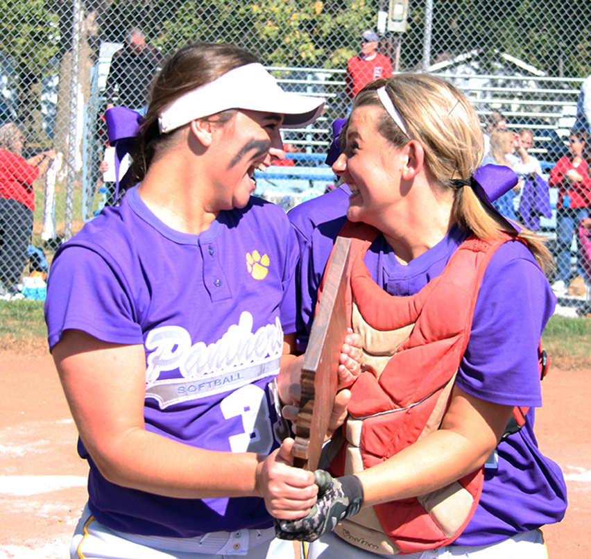 ROSS MARTIN/Citizen photo North Platte seniors Victoria Haugsness, left, and Martina Williams celebrate while holding the Class 2 District 14 championship trophy on Saturday, Oct. 10 at Heritage Park in Gower, Mo.