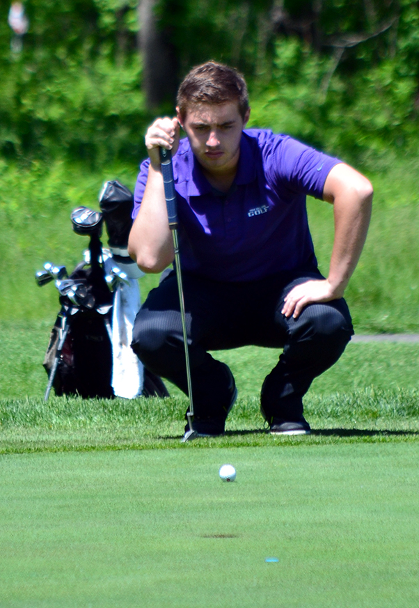 BRYCE MERENESS/Citizen photo Park Hill South junior Tanner Owen lines up a putt during Class 4 Sectional 4 play Monday, May 11 at Adams Pointe Golf Course in Blue Springs, Mo.