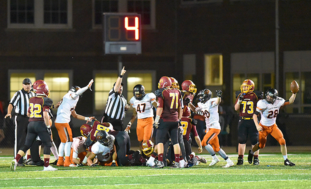 TODD NUGENT/Special to the Citizen Platte County sophomore linebacker Dakota Schmidt, left, emerges from the pile with a fumble recovery for the Pirates against Winnetonka on Friday, Sept. 18 at North Kansas City District Stadium in North Kansas City, Mo.