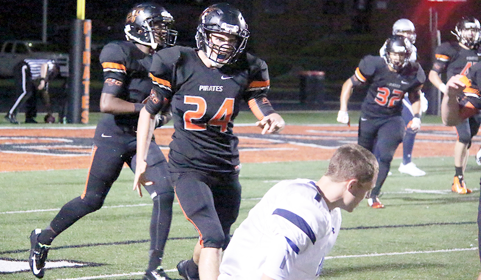 ROSS MARTIN/Citizen Photo Johnny Blankenship (24) celebrates a game-clinching pass breakup against St. Joseph Central last Friday at Pirate Stadium while Indians wide receiver Gage Stagner, center, reacts to the loss. Platte County won 29-22 in a game delayed multiple times by lightning.
