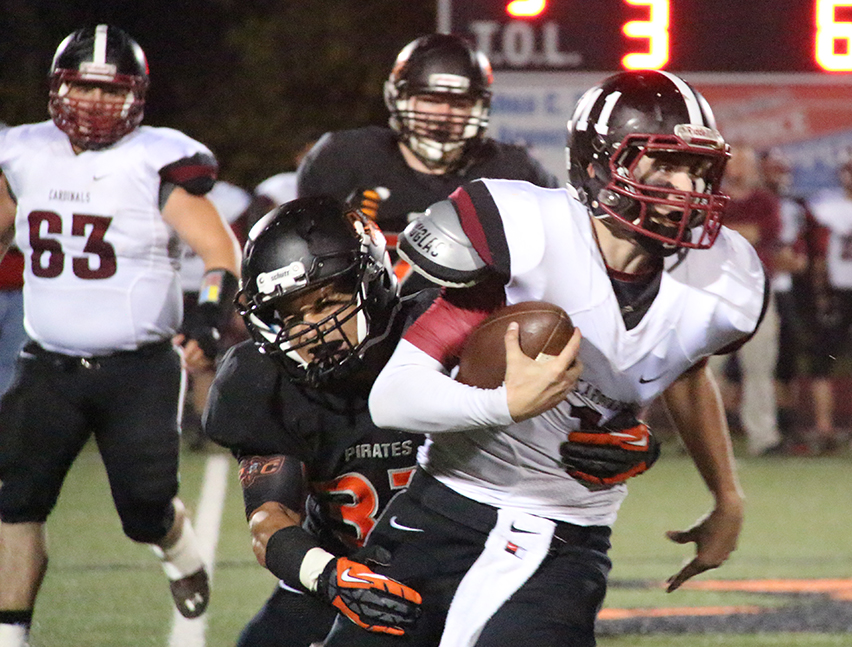 ROSS MARTIN/Citizen photo Platte County linebacker Christian Encarnacion, left, sacks Benton quarterback Dominic Hill during an Oct. 24 game at Pirate Stadium in the opening round of Class 4 District 8 play.  The Pirates won 58-13.
