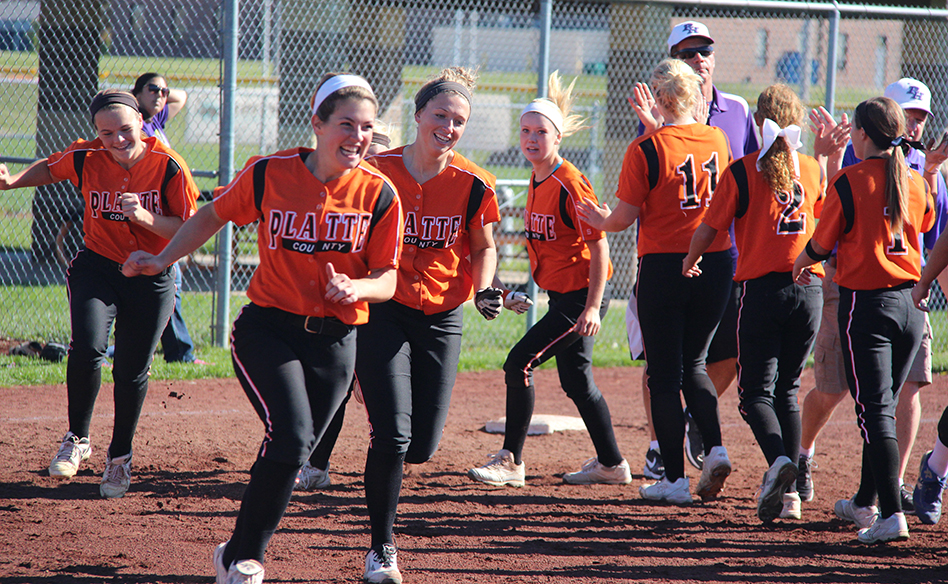 Platte County shortstop Jesse Hoover leads the Pirates' celebratory sprint after the post-game handshake following a 6-5 victory against Pleasant Hill on Oct. 18 at Platte County High School.