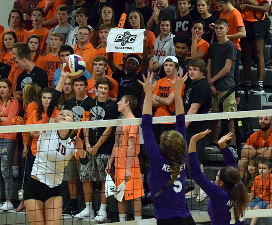 BRYCE MERENESS/Citizen photo Platte County outside hitter Kenzie Polley (10) hits a spike against Kearney on Thursday, Oct. 8 at Platte County High School. Platte County won the match in three sets to tie Kearney for the Suburban Conference Blue Division lead.