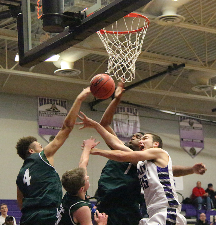 ROSS MARTIN/Citizen photo Park Hill South senior forward, Allen Hiatt, right goes for a rebound against Barstow on Dec. 5 at Park Hill South High School in Riverside, Mo. Park Hill South lost 65-49 for its first loss of the season.