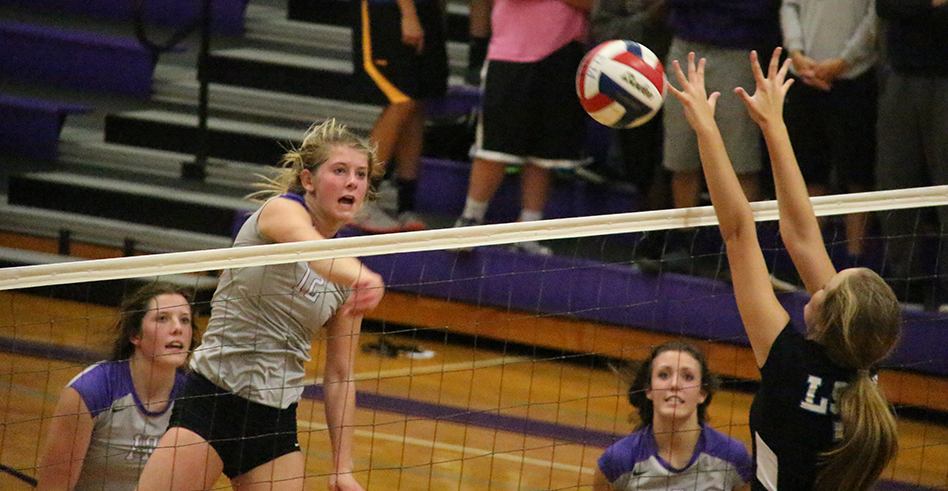 ROSS MARTIN/Citizen photo Park Hill South's Andi Elley spikes the ball during a match against Lee's Summit West on Oct. 9 at Park Hill South High School in Riverside, Mo.