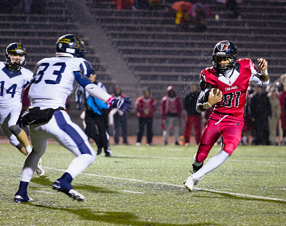 CORY MACNEIL/Citizen photo Park Hill wide receiver Quinton Harris, right, attempts to evade a tackle from a Liberty North Defender on Friday, Oct. 30 at Park Hill District Stadium in Kansas City, Mo.
