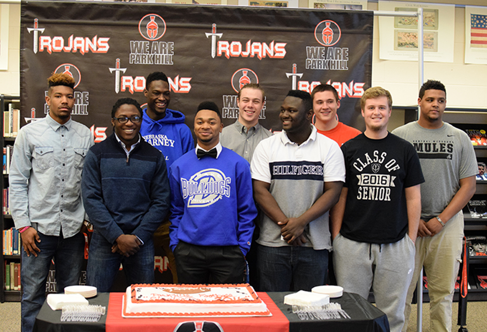BRYCE MERENESS/Citizen photo Park Hill seniors (from left) Davion Tyler, Matt Harris, Kentrez Bell, Malik James, Kyle Blydenburg, Desmond Sturgis, Michael Marfield, Kolin Hayes and Jamar Grant all signed national letters of intent to play college football during a ceremony Wednesday, Feb. 3 at Park Hill High School in Kansas City, Mo.