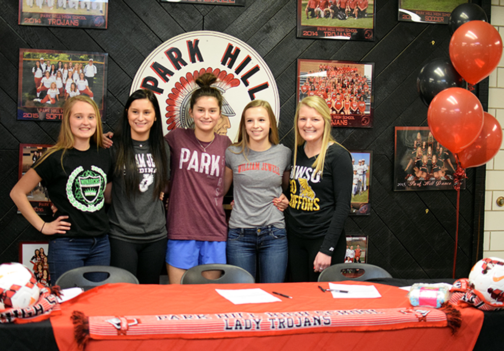 BRYCE MERENESS/Citizen photo Park Hill soccer players Heather Wojahn, Bella Catano, Taylor Buckholz, Haley Buckholz and Madi Massa signed to play in college during a ceremony Wednesday, Feb. 3 at Park Hill High School in Kansas City, Mo.