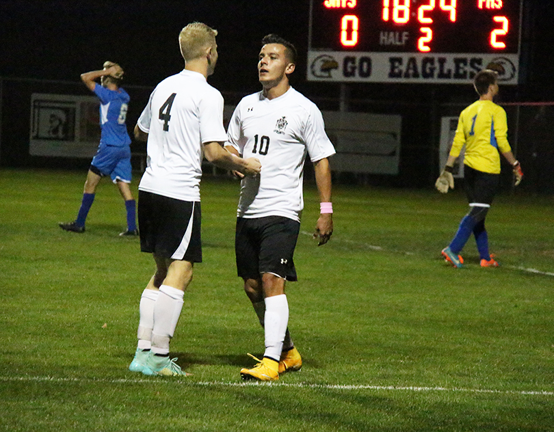 BRYCE MERENESS/Citizen photo Park Hill South winger Tanner Alderson (4) congratulates Dylan Kintner after his goal in a 3-0 win against Liberty on Oct. 30 at Liberty Middle School in Liberty, Mo. in the Class 4 District 15 championship game.