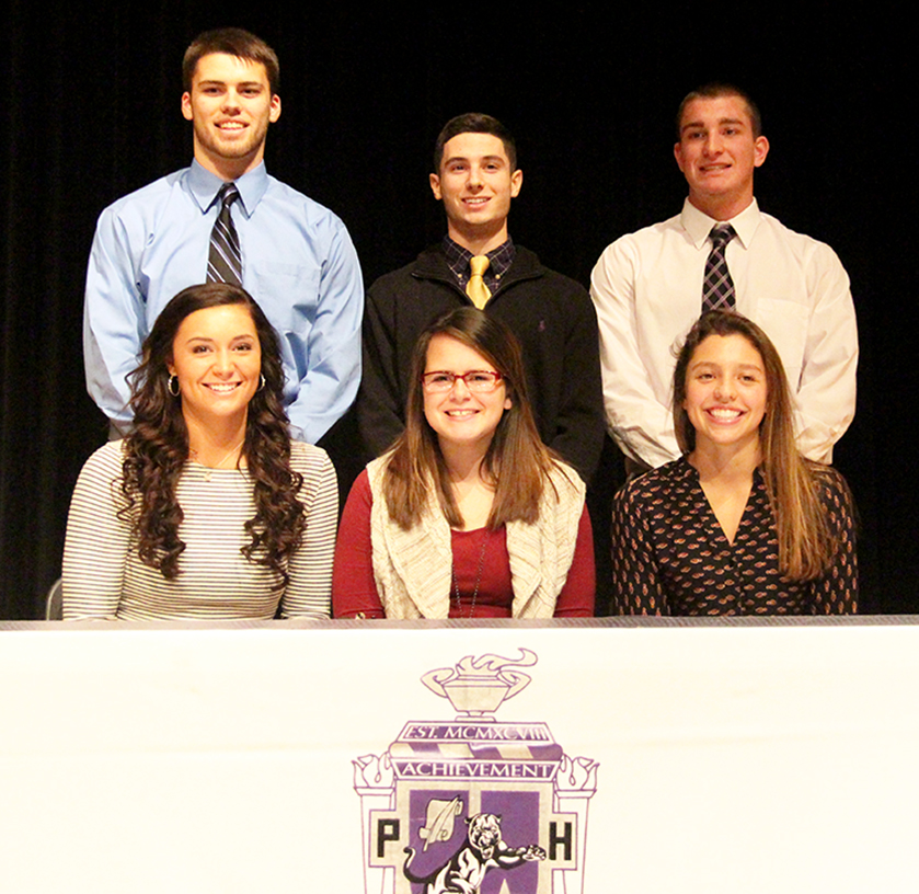 ROSS MARTIN/Citizen photo Six soccer players from Park Hill South signed national letters of intent to continue their careers in college on Wednesday, Feb. 2 at Park Hill South High School. Those signing included (back row, left to right) Seth Hudson, Carson Cavitt-Wells and Evan Morrow and (front row, left to right) Madi Sanders, Sadie Grigsby and Mayleigh Oder.