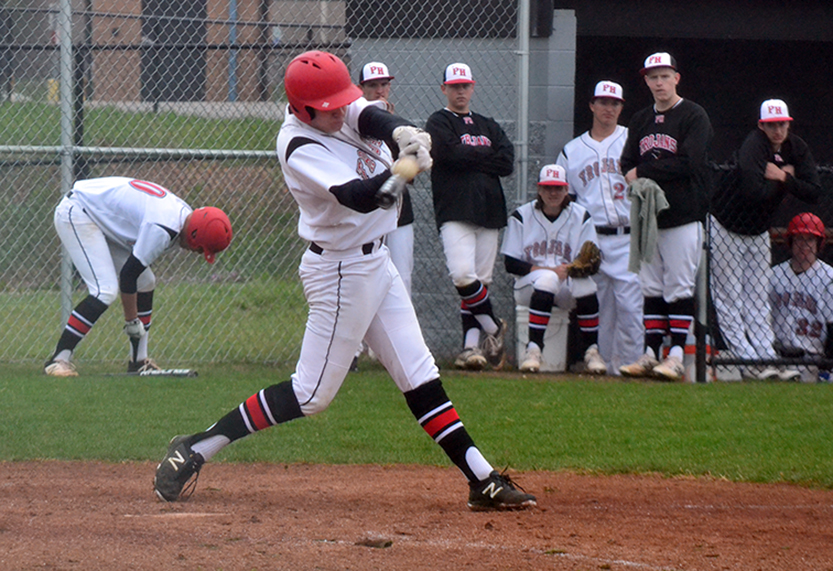 BRYCE MERENESS/Citizen photo Park Hill sophomore Parker Sampson makes contact with a pitch in a game against St. Joseph Central on Monday, April 6 at Park Hill High School in Kansas City, Mo.