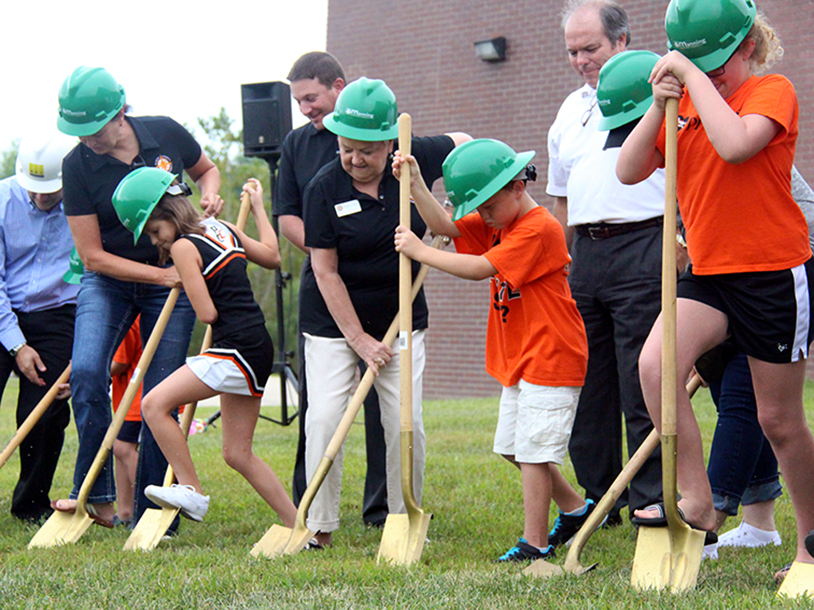 ROSS MARTIN/Citizen photo From left, Platte County R-3 board of education member Lenora Miles, third grade student Delaney Thomas, board president Sharon Sherwood, second grade student Gabe Elliott and fourth grade student Chloe Borgmeyer dig their shovels in during a ceremonial groundbreaking held Saturday, Aug. 29 at Pathfinder Elementary in Kansas City, Mo. The school will undergo a renovation project, set to begin soon.