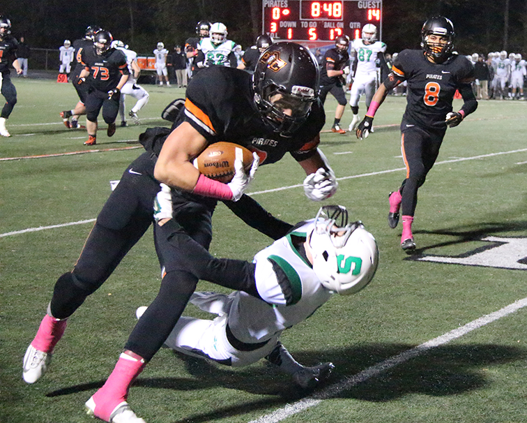ROSS MARTIN/Citizen photo Platte County wide receiver Tyler Cooper, left, runs over a Smithville defender Oct. 31 at Pirate Stadium. The Warriors defeated Platte County 44-38 in the Class 4 District 8 semifinal.