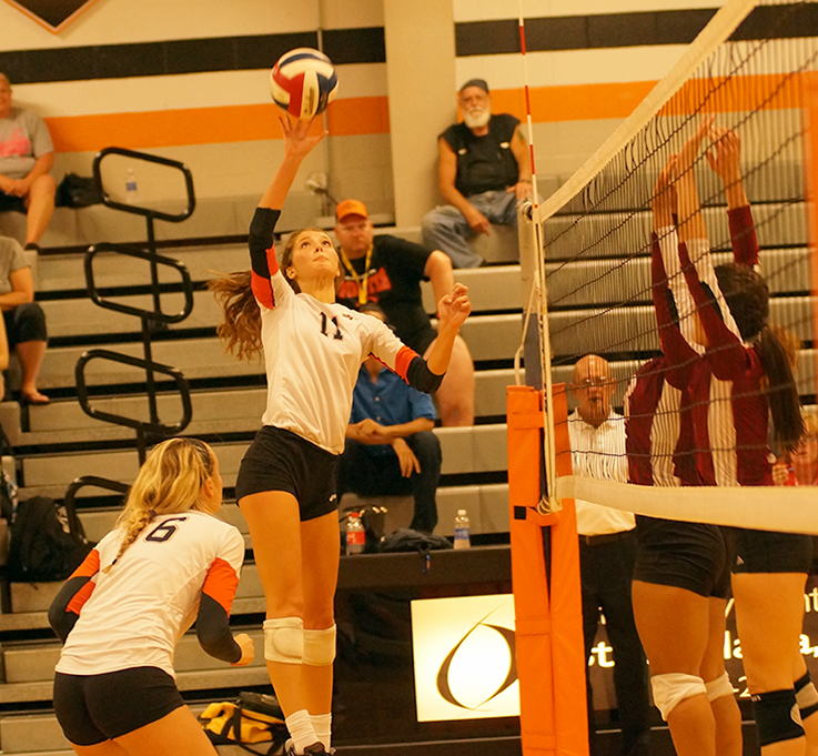 CHRIS PATTERSON/Citizen photo Platte County's senior Kennedy Knox tips the ball over the net in the Pirates match against Winnetonka on Thursday, Sept. 3 at Platte County High School.