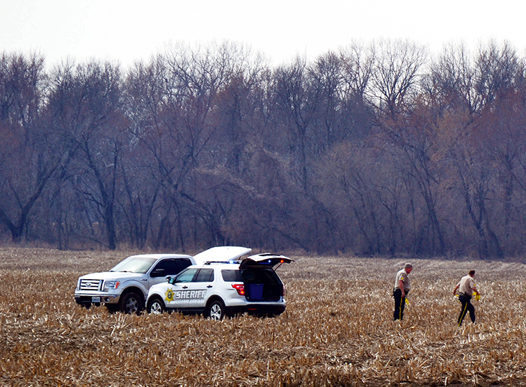 BRYCE MERENESS/Citizen photo Members of law enforcement search a field located south and west of Highway 92 near Tracy, Mo. on the afternoon of Tuesday, March 10. A suspect who led police on a chase through northwestern Platte County minutes earlier was taken into custody at the scene shortly after his vehicle became disabled.