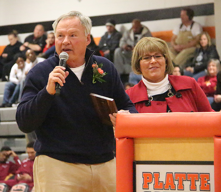 R.B. Miller, left, inducted into the Pirate Hall of Fame during a ceremony on Friday, Feb. 27 at halftime of Platte County's boys basketball game at Platte County High School.