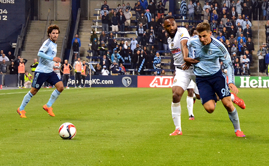 BRYCE MERENESS/Citizen photo Philadelphia Union defender Raymond Lee, center, a Park Hill graduate, defends Sporting KC forward Krisztian Nemeth. Lee made his MLS debut as a 78th-minute substitute in the Union's 3-2 loss to Sporting Kansas City on Sunday, April 5 at Sporting Park in Kansas City, Kan.