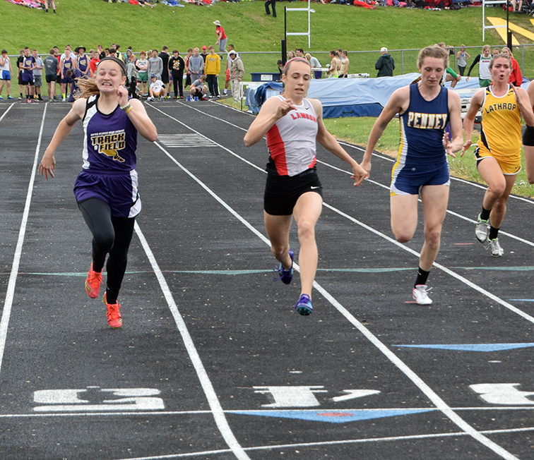 BRYCE MERENESS/Citizen photo North Platte's Regan Nash, left, races against Lawson's Nikki Smith, center, and Hamilton's Morgan Prather in the 100-meter dash during the KCI Conference Meet on Saturday, May 2 at North Platte High School in Dearborn, Mo.